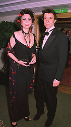 Model MARIE HELVIN and MR MARK CROWDY, at a ball in London on 20th November 1997.MDN 33