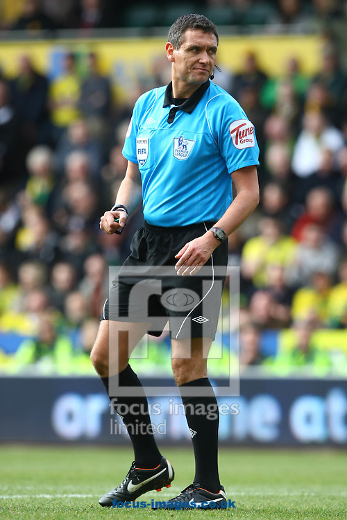 Picture by Paul Chesterton/Focus Images Ltd.  07904 640267.26/02/12.Referee Andre Marriner during the Barclays Premier League match at Carrow Road Stadium, Norwich.