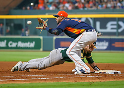 April 29, 2018 - Houston, TX, U.S. - HOUSTON, TX - APRIL 29:  Oakland Athletics catcher Jonathan Lucroy (21) slides back into first base during the baseball game between the Oakland Athletics and Houston Astros on April 29, 2018 at Minute Maid Park in Houston, Texas.  (Photo by Leslie Plaza Johnson/Icon Sportswire) (Credit Image: © Leslie Plaza Johnson/Icon SMI via ZUMA Press)