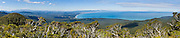 See the South Pacific Ocean from atop the Tuatapere Hump Ridge Track, in Fiordland National Park, South Island, New Zealand. In 1990, UNESCO honored Te Wahipounamu - South West New Zealand as a World Heritage Area. Panorama stitched from 6 overlapping photos.