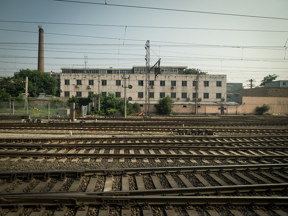 Leaving Xian's station. Life in the train from Hong Kong to Urumqi (Xinjiang).