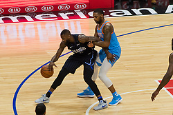 March 10, 2018 - Los Angeles, CA, U.S. - LOS ANGELES, CA - MARCH 10: LA Clippers guard Sindarius Thornwell (0) defends Orlando Magic forward Jonathon Simmons (17) during the game between the Orlando Magic and the LA Clippers on March 10, 2018, at STAPLES Center in Los Angeles, CA. (Photo by David Dennis/Icon Sportswire) (Credit Image: © David Dennis/Icon SMI via ZUMA Press)
