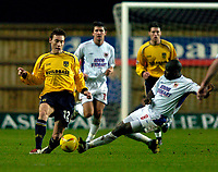 Photo: Richard Lane.<br />Oxford United v Carlisle United. Nationwide Division Three. 13/12/2003.<br />Dean Whitehead is challenged by Chris Billy.