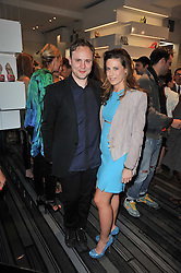 FRANCESCA VERSACE and NICHOLAS KIRKWOOD at the opening party for Nicholas Kirkwood's new store at 5 Mount Street, London on 12th May 2011.
