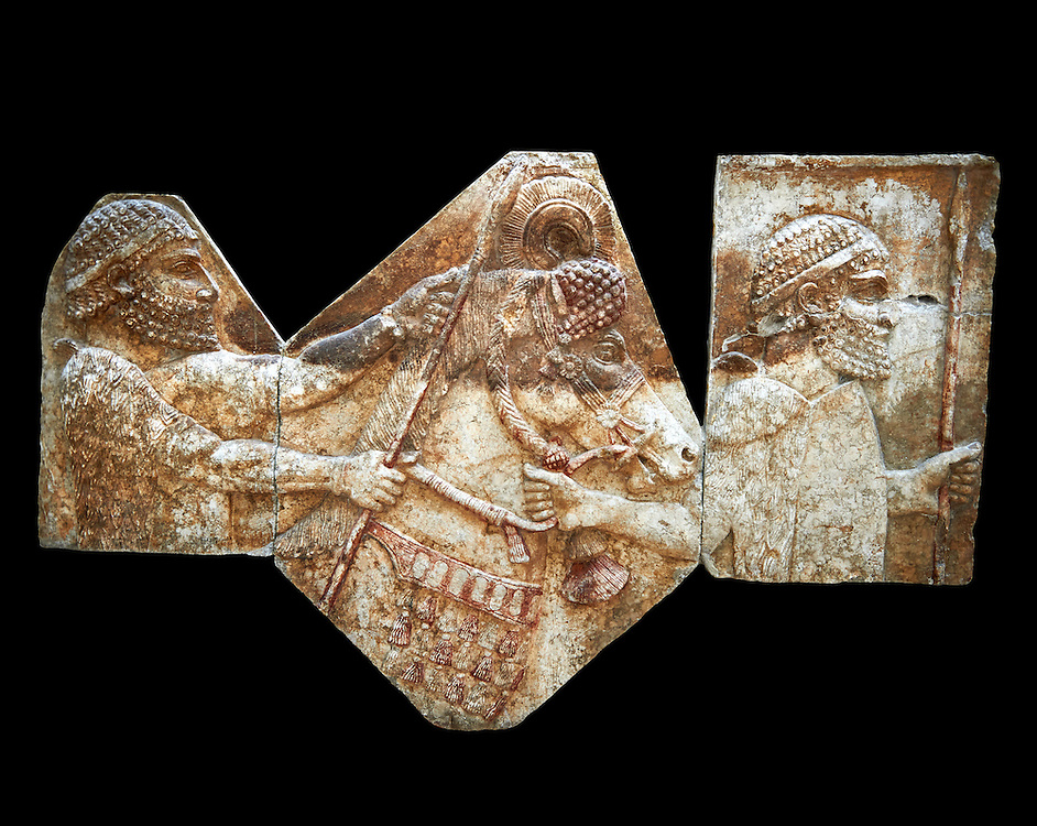 Stone relief sculptured panel of tributaries. From corridor 10,  Inv AO 1433/19899/19895 from Dur Sharrukin the palace of Assyrian king Sargon II at Khorsabad, 713-706 BC.  Louvre Museum Room 4 , Paris .<br /> <br /> If you prefer to buy from our ALAMY PHOTO LIBRARY  Collection visit : https://www.alamy.com/portfolio/paul-williams-funkystock/ancient-assyria-antiquities.html  Refine search by adding background colour, place, subject, museum etc into the LOWER SEARCH WITHIN GALLERY box to <br /> <br /> Visit our ANCIENT ASSYRIAN PHOTO COLLECTIONS for more photos to download or buy as wall art prints https://funkystock.photoshelter.com/gallery-collection/Ancient-Assyrian-Art-Artefacts-Antiquities-Historic-Sites-Pictures-Images-of/C0000cjRqQyJjLag