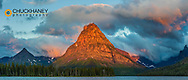 Sunrise light on Sinopah Mountain and Two Medicine Lake in Glacier National Park, Montana, USA