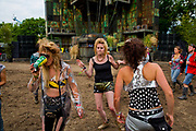 "Ravers in Block 9, ""Hovering in the shadows of an ancient industrial power facility, a towering concrete and glass structure lies dormant and overgrown. This is Genosys. Short for Generated Oxygen System, this epic, brutalist 'tree' was built to save the once poisoned planet. It nurtured and preserved plant life within its huge tanks and, as it drank in the excess atmospheric carbon, it poured out fresh oxygen. Lost and forgotten, Genosys has lain silent until now…""<br /> An audiovisual hybrid that blurs the boundaries between art and music, Genosys celebrates the pre-digital dance floor in spectacular style. Originally a Thames Arts commission, the 50ft structure was designed by Block9 for 'The Tree of Light', a series of large-scale outdoor theatre performances and part of the London 2012 Cultural Olympiad.Glastonbury Festival is the largest greenfield festival in the world, and is now attended by around 175,000 people. It's a five-day music festival that takes place near Pilton, Somerset, England. In addition to contemporary music, the festival hosts dance, comedy, theatre, circus, cabaret, and other arts. It is organised by Michael Eavis on his own land, Worthy Farm in Pilton. Leading pop and rock artists have headlined, alongside thousands of others appearing on smaller stages and performance areas."
