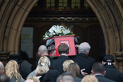 © Licensed to London News Pictures . 20/12/2017. Manchester, UK. The funeral of 14-year-old Sam Berkley at Christ Church in Denton , East Manchester . Mourners wear red and white , the colours of Hattersley FC , for whom Berkley played . Amongst their number are pupils and friends from Audenshaw School . Berkley died after being hit by a grey BMW near junction 3 of the M67 in Hyde , East Manchester , on 1st December 2017 . Photo credit: Joel Goodman/LNP