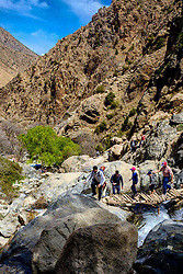 Tourists on the steep narrow trail into the Atlas towards the Setti-Fatma waterfalls<br /> <br /> (c) Andrew Wilson | Edinburgh Elite media