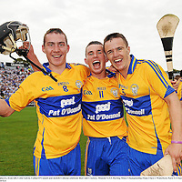 10 July 2011; Clare players, from left, Colm Galvin, Cathal O'Connell and Jarleth Colleran celebrate their side's victory. Munster GAA Hurling Minor Championship Final, Clare v Waterford, Pairc Ui Chaoimh, Cork. Picture credit: Stephen McCarthy / SPORTSFILE