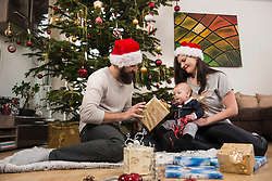 Father holding Christmas gift