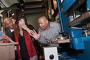 Ellen ten Damme schrikt van het geluid dat de machine maakt, de operator stelt haar gerust. Bij de Munt in Utrecht slaan onder toeziend oog van gastheer minister Jan Kees de Jager (links) Humberto Tan en Ellen ten Damme, beide ambassadeurs voor het WNF, de eerste slag van een muntje ter ere van het vijftig jarig bestaan van het Wereld Natuur Fonds. De munt is ontworpen door Willehad Eilers (tweede van links).<br /> <br /> At the Munt in Utrecht Ellen ten Damme and Humberto Tan, both ambassadors of the Dutch WWF, are pressing the first example of a special Euro coin to celebrate the fiftieth birthday of the World Wildlife Fund.