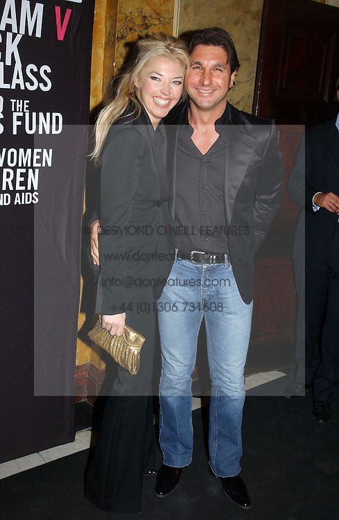 MISS TAMARA BECKWITH and MR GEORGE VERONI at a party to celebrate Pamela Anderson's new role as spokesperson and newest face of the MAC Aids Fund's Viva Glam V Campaign held at Home House, Portman Square, London on 21st April 2005.<br /><br />NON EXCLUSIVE - WORLD RIGHTS