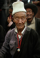 """A tibetan man with a picture of the Dalai Lama, Lhasa, Tibet, 1990<br /> Available as Fine Art Print in the following sizes:<br /> 08""""x12""""US$   100.00<br /> 10""""x15""""US$ 150.00<br /> 12""""x18""""US$ 200.00<br /> 16""""x24""""US$ 300.00<br /> 20""""x30""""US$ 500.00"""