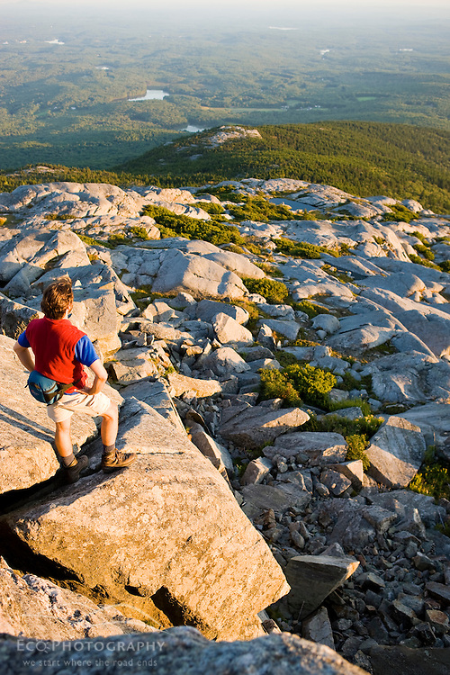 A hiker on the summit of Mount Monadnock in New Hampshire's Monadnock State Park.