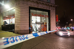 © Licensed to London News Pictures. 08/02/2017. Leeds UK. Picture shows police outside the Sainsbury's shop on the Headrow in Leeds this morning after a firearms incident last night. A man has been arrested & remains in custody. Photo credit: Andrew McCaren/LNP