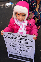 """London, February 8th 2015. Muslims demonstrate outside Downing Street  """"to denounce the uncivilised expressionists reprinting of the cartoon image of the Holy Prophet Muhammad"""". PICTURED: A little girl poses for the camera with her placard."""