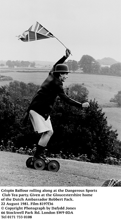 Crispin Balfour rolling along at the Dangerous Sports Club Tea party. Given at the Gloucestershire home of the Dutch Ambassador Robbert Fack. 22 August 1981. Film 8197f36<br />© Copyright Photograph by Dafydd Jones<br />66 Stockwell Park Rd. London SW9 0DA<br />Tel 0171 733 0108