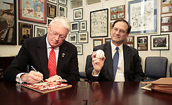 Jan. 24, 2006 - U.S. - Samuel Alito, the Republican White House nominee for the U.S. Supreme Court, met with Sen. Jim Bunning (R-KY).  Bunning presented Alito with a baseball, and signed Alito's Bunning-era Phillies program in his Capitol Hill Office in Washington, DC January 24, 2006. (Chuck Kennedy/KRT) (Credit Image: © Chuck Kennedy/TNS/ZUMAPRESS.com)