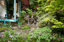 Gosho No Niwa No Wall, No War, Japanese garden with copper clad glass structure and waterfall. Design: Kazuyuki Ishihara, Sponsored by: G-LION.<br /> RHS Chelsea Flower Show 2017