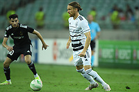 Abdellah Zoubir (10) of Qarabag FK fights for the ball with Michael Lang (5) of FC Basel  during the UEFA Europa Conference League group H match between Qarabag FK and FC Basel at  on September 16, 2021 in Baku, Azerbaijan.