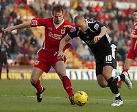 Photo: Ed Godden.<br />Bristol City v Swansea. Coca Cola League 1. 28/01/2006.<br />Swansea's Lee Trundle (R) stumbles on the ball in the Bristol City area.
