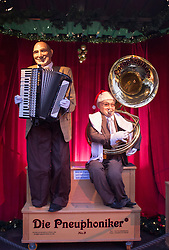 traditional coin operated music machine with accordion and Tuba at Cologne Christmas Market in Germany
