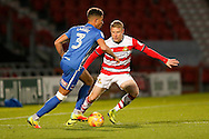 Hartlepool United  defender Jake Carroll (3)  tries to go past Doncaster Rovers defender Craig Alcock (2)  during the EFL Sky Bet League 2 match between Doncaster Rovers and Hartlepool United at the Keepmoat Stadium, Doncaster, England on 19 November 2016. Photo by Simon Davies.