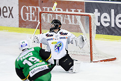 16.12.2012, Hala Tivoli, Ljubljana, SLO, EBEL, HDD Telemach Olimpija Ljubljana vs Dornbirner Eishockey Club, 31. Runde, in picture Ziga Pance (HDD Telemach Olimpija, #19) scores a goal vs Patrick Desrochers (Dornbirner Eishockey Club, #37) during the Erste Bank Icehockey League 31st Round match between HDD Telemach Olimpija Ljubljana and Dornbirner Eishockey Club at the Hala Tivoli, Ljubljana, Slovenia on 2012/12/16. (Photo By Matic Klansek Velej / Sportida)