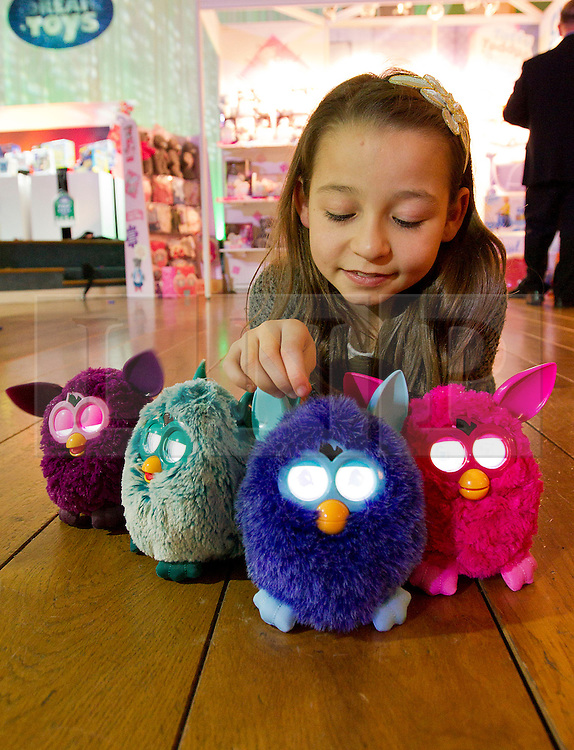 © Licensed to London News Pictures. 31/10/2012. London, UK. 10 year old Natalya Wallace plays with four Hasbro Furbys (RRP GB£59.99) in London today (31/10/12) as the Toy Retailers Association releases its 13 Dream Toys for Christmas 2012. Photo credit: Matt Cetti-Roberts/LNP