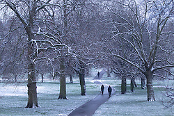 © Licensed to London News Pictures. 14/01/2013. London, UK. Members of the public are seen walking through Primrose Hill  in London today (14/01/2013) after the UK saw the first snow of 2013 fall across the country. Photo credit: Matt Cetti-Roberts/LNP