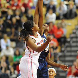Notre Dame Fighting Irish forward Devereaux Peters (14) and Rutgers Scarlet Knights forward/center Monique Oliver (34) top off during first half NCAA Big East women's basketball action between Notre Dame and Rutgers at the Louis Brown Athletic Center. Notre Dame leads 40-23 at halftime.