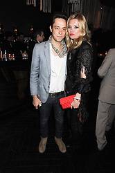 KATE MOSS and JAMIE HINCE at a party to celebrate the 1st anniversary of W Doha in partnership with The Old Vic, held at Chinawhite, 4 Winsley Street, London on 22nd March 2010.