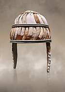 Minoan boar's tusk helmet with cheek guards,1450-1300 BC, Heraklion Archaeological Museum.  More below......<br /> <br /> This restored boars tusk helmet was described in Homers Iliad being worn by Cretan hero Meriones. It bis believed that the helmet was ceremonial depicting the rank of an officer. .<br /> <br /> If you prefer to buy from our ALAMY PHOTO LIBRARY  Collection visit : https://www.alamy.com/portfolio/paul-williams-funkystock/minoan-art-artefacts.html . Type -   Heraklion   - into the LOWER SEARCH WITHIN GALLERY box. Refine search by adding background colour, place, museum etc<br /> <br /> Visit our MINOAN ART PHOTO COLLECTIONS for more photos to download  as wall art prints https://funkystock.photoshelter.com/gallery-collection/Ancient-Minoans-Art-Artefacts-Antiquities-Historic-Places-Pictures-Images-of/C0000ricT2SU_M9w