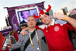 Supporters of Denmark celebrate at Fan zone in the City centre during the UEFA EURO 2012 match between Netherlands and Denmark on June 9, 2012 in Fan zone Warsaw, Poland.  (Photo by Vid Ponikvar / Sportida.com)