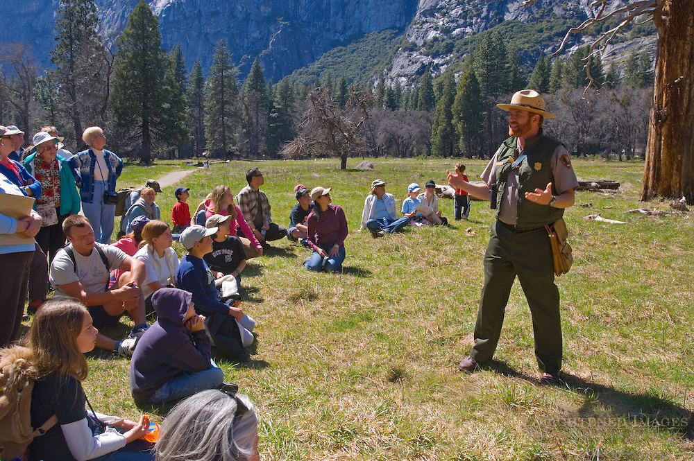 Tourist and visitors on Ranger led natural history discovery education walk lecture talk, Yosemite Valley, California