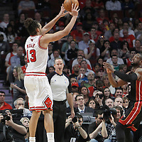 14 March 2012: Chicago Bulls center Joakim Noah (13) takes a jumpshot during the Chicago Bulls 106-102 victory over the Miami Heat at the United Center, Chicago, Illinois, USA.
