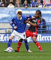 Photo: Mark Stephenson.<br />Leicester City v Queens Park Rangers. Coca Cola Championship. 17/03/2007. Leicester's Mark Yates wins the ball from QPR's Michael Mancienne