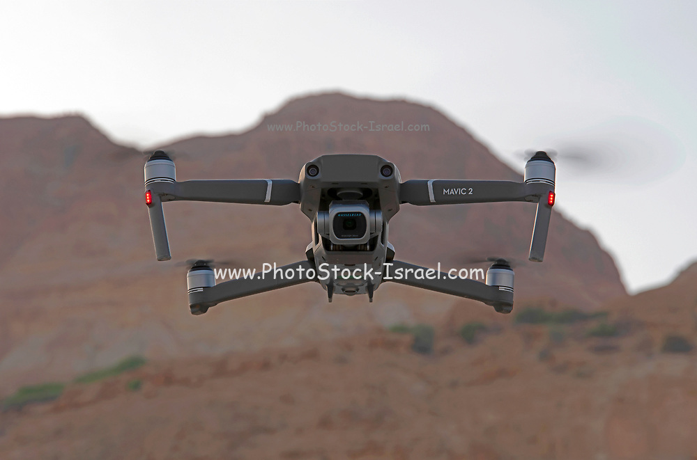 Remote control Quadrocopter, drone, with Hasselblad camera spying on the viewer