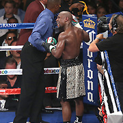LAS VEGAS, NV - SEPTEMBER 13: Referee Kenny Bayless speaks to Floyd Mayweather Sr. in the corner after Floyd Mayweather Jr. claims that Marcos Maidana bit his hand during their WBC/WBA welterweight title fight at the MGM Grand Garden Arena on September 13, 2014 in Las Vegas, Nevada. (Photo by Alex Menendez/Getty Images) *** Local Caption *** Floyd Mayweather Jr; Marcos Maidana; Kenny Bayless; Floyd Mayweather Sr.