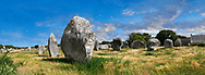 View of Carnac neolthic standing stones monaliths, Alignements du Menec, a pre-Celtic site of standing stomes used from 4500 to 2000 BC,<br /> <br /> Carnac is famous as the site of more than 10,000 Neolithic standing stones, also known as menhirs. The stones were hewn from local rock and erected by the pre-Celtic people of Brittany. The Carnac stones were erected during the Neolithic period which lasted from around 4500 BC until 2000 BC. One interpretation of the site is that successive generations visited the site to erect a stone in honour of their ancestors. '<br /> <br /> Visit our PREHISTORIC PLACES PHOTO COLLECTIONS for more  photos to download or buy as prints https://funkystock.photoshelter.com/gallery-collection/Prehistoric-Neolithic-Sites-Art-Artefacts-Pictures-Photos/C0000tfxw63zrUT4