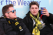 two Borussia Dortmund fans having a drink outside White Hart Lane Stadium before k/o. UEFA Europa League round of 16, 2nd leg match, Tottenham Hotspur v Borussia Dortmund at White Hart Lane in London on Thursday 17th March 2016<br /> pic by John Patrick Fletcher, Andrew Orchard sports photography.