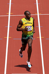 Usain Bolt of Jamaica eases up after winning his heat during The Men's 100m heats held on day 2 of athletics held at the Olympic Stadium in Olympic Park in London as part of the London 2012 Olympics on the 3rd August 2012..Photo by Ron Gaunt/SPORTZPICS