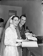 18/11/1952<br /> 11/18/1952<br /> 18 November 1952<br /> Wedding of Lieutenant Seamus Lillis, (son of Colonel James Lillis, Army Chief of Staff) Collins Barracks, Cork and Miss Aureed Mundy, Donegal at Ross Nuala and Bundoran, Co. Donegal. The couple sign the register after the ceremony.