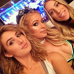 """Paris Hilton releases a photo on Instagram with the following caption: """"Thank you @DianeBuzzetta \u0026 @MandiiCakes for getting me ready all weekend for #EDC! Shout out to my friend @MichaelBoychuckLV @ColorSalonLV! Loving your new makeup brush line!! \ud83d\ude3b"""". Photo Credit: Instagram *** No USA Distribution *** For Editorial Use Only *** Not to be Published in Books or Photo Books ***  Please note: Fees charged by the agency are for the agency's services only, and do not, nor are they intended to, convey to the user any ownership of Copyright or License in the material. The agency does not claim any ownership including but not limited to Copyright or License in the attached material. By publishing this material you expressly agree to indemnify and to hold the agency and its directors, shareholders and employees harmless from any loss, claims, damages, demands, expenses (including legal fees), or any causes of action or allegation against the agency arising out of or connected in any way with publication of the material."""