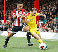 yet another battle on the wing for possession between Brentford forward Sergi Canos and Rotherham United midfielder Aidan White during the Sky Bet Championship match between Brentford and Rotherham United at Griffin Park, London, England on 17 October 2015. Photo by Andy Walter.
