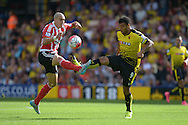 Oriol Romeu of Southampton and Troy Deeney, the Watford captain ® challenge for the ball. Barclays Premier League, Watford v Southampton at Vicarage Road in London on Sunday 23rd August 2015.<br /> pic by John Patrick Fletcher, Andrew Orchard sports photography.