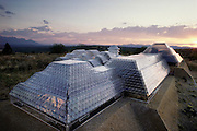 Model of Biosphere 2 Project buildings photographed at sunset on the building site. The Biosphere was a privately funded experiment, designed to investigate the way in which humans interact with a small self-sufficient ecological environment, and to look at possibilities for future planetary colonization.  1986