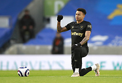 West Ham United's Jesse Lingard takes a knee and raises a fist in support of Black Lives Matter prior to kick-off during the Premier League match at the American Express Community Stadium, Brighton. Picture date: Saturday May 15, 2021.