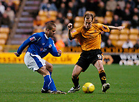 Photo: Leigh Quinnell.<br /> Wolverhampton Wanderers v Leicester City. Coca Cola Championship. 09/12/2006. Wolves' Jamie Clapham looks for a way past Leicesters  James Wesolowski.